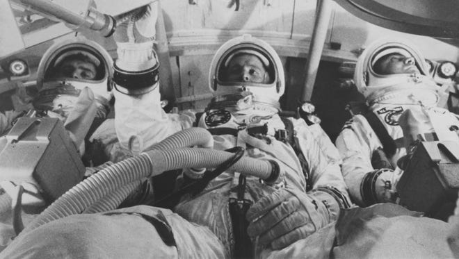 Astronauts Virgil Grissom (right), Edward White (center). and Roger Chaffee are shown training for the first three-man Apollo space flight.