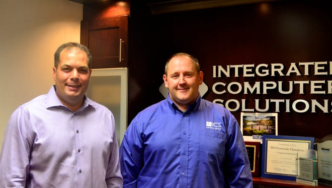 Kevin Blake, left, and Travis Hayes own ICS Solutions Group in Endicott. Blake serves as the company's president and Hayes is the chief technology officer.