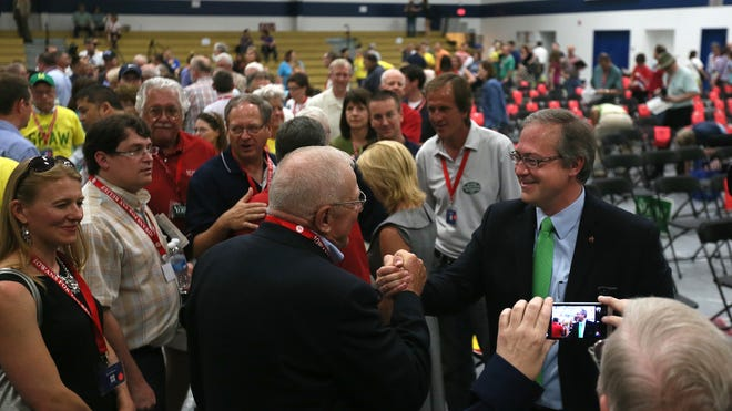 David Young is congratulated Saturday after getting the GOP nomination in Iowa's 3rd District U.S. House race at a party convention in Des Moines.