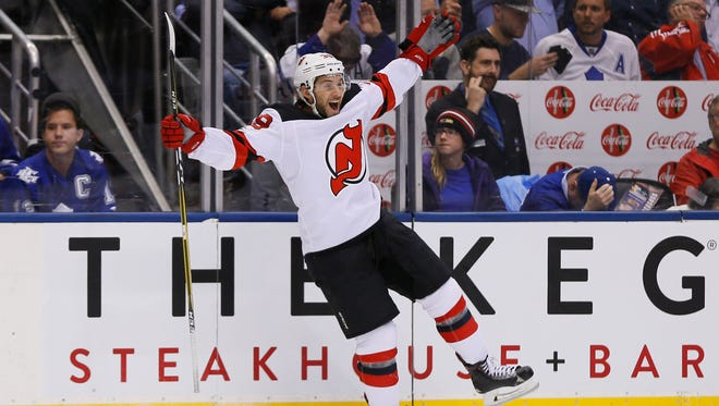 Devils forward Brian Gibbons (39) celebrates his short-handed goal against the Toronto Maple Leafs during the second period at the Air Canada Centre on Oct. 11, 2017.