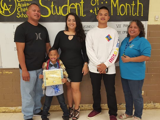 The Guahan Academy Charter School honored its February Student of the Month awardees on March 8. Pictured front row: Tyson Quinata. Back row from left: Anthony Quinata; April Gogo; Austin Quinata and Mary Mafnas, Dean of Elementary School Guahan Academy Charter School.