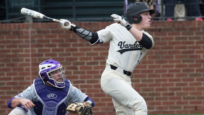 Vanderbilt second baseman Ethan Paul (10) watches his hit fly up the field during their game against University of Evansville at Hawkins Field Wednesday, Feb. 22, 2017 in Nashville, Tenn.