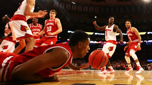 Troy Williams #5 of the Indiana Hoosiers falls chasing the ball against the Louisville Cardinals during their game at the Jimmy V Classic in Madison Square Garden on December 9, 2014 in New York City.