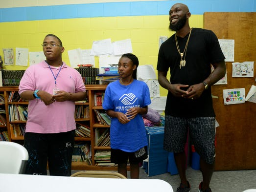 Sacramento Kings power forward Reggie Evans gets a tour of the the Boys and Girls Club of the Emerald Coast in Pensacola on Thursday with club members Joerrell Kinion and Lajazmond Wilson.