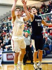Oak Harbor's Clay Schulte tries to score against Carey.