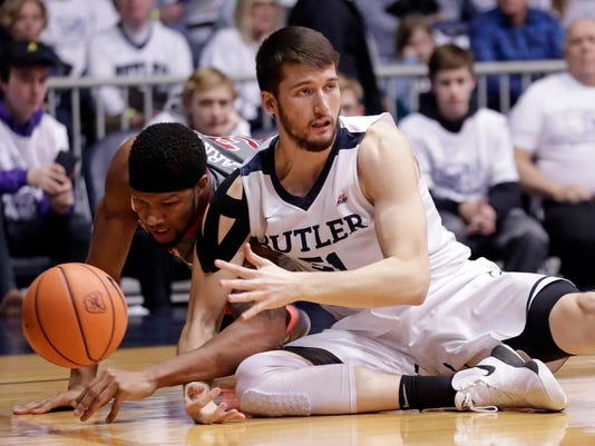 Butler center Nate Fowler, right, and St. John's forward Marvin Clark II (13) go to the floor for a loose ball in the first half of an NCAA college basketball game in Indianapolis, Saturday, Jan. 27, 2018. (AP Photo/Michael Conroy)