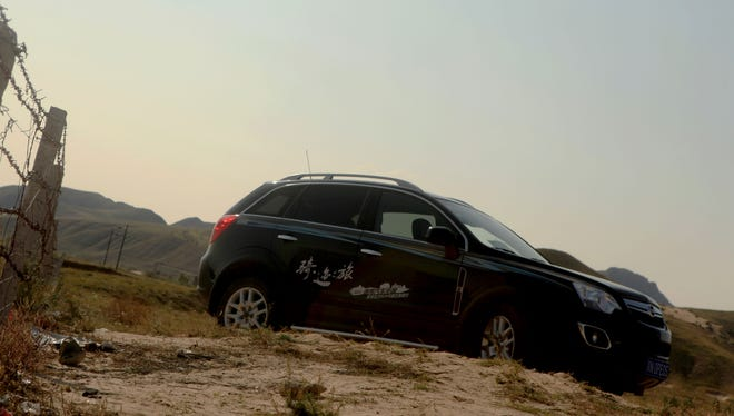 A Chinese-model Opel Antara -- Opel's best-selling vehicle in China -- on a sand road in Inner Mongolia during a General Motors China event last fall.