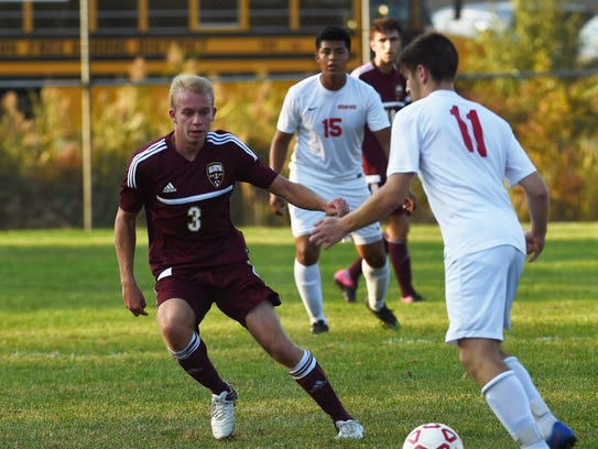 Arlington's Peter Petrillo, left, tries to get the
