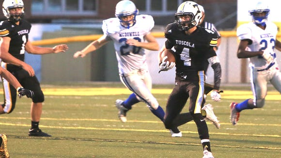 Tuscola's Roman Jenkins carries the ball during last year's 35-20 loss to McDowell in Waynesville. The same two teams play Friday in Marion.