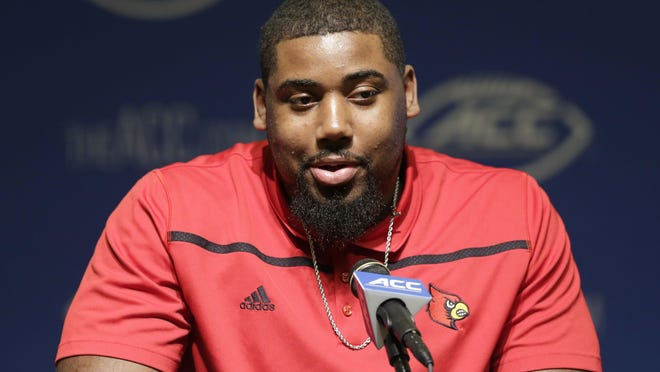 Louisville's Sheldon Rankins responds to questions during the ACC's football kickoff on Monday.