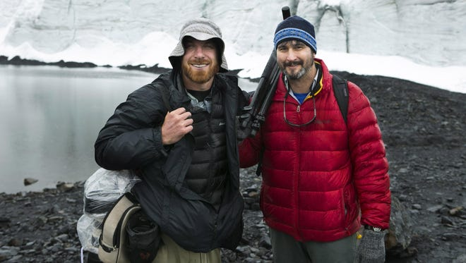 Arizona Republic photographer David Wallace, left, and Arizona Republic environmental reporter Brandon Loomis are seen at the Pastoruri Glacier in the Huascaran National Park in the Andes Mountains of Peru on March 4, 2015. They traveled to South America and to Colorado.