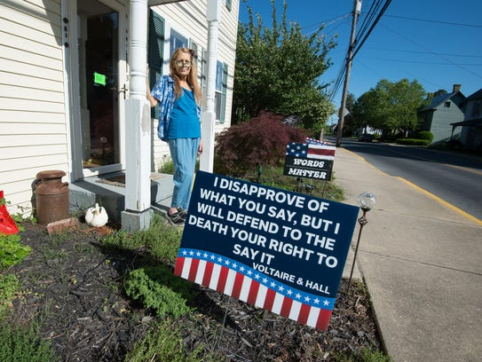 Signs outside the home of Penny Nickerson in Milton
