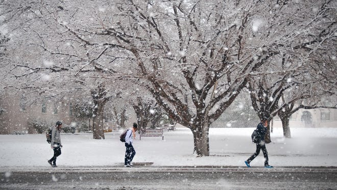 NMSU Students make their way on campus through a blizzard on January 22nd.