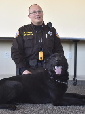 """Matt Tassoul of the Door County Sheriff's Department answers audience questions during """"Coffee with a Cop & K9.'' Tassoul works with Odinn, a black German shepherd. Its been nearly 30 years since the department provided canine search services."""