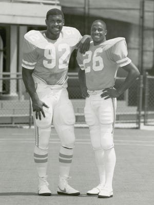 University of Tennessee football players Reggie White, left, and Willie Gault in an undated photo.