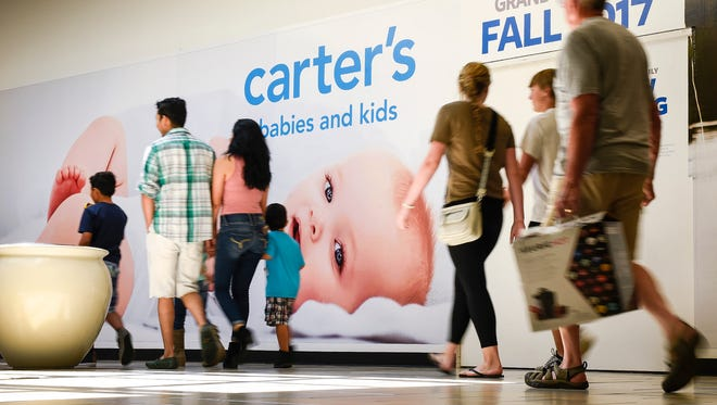 Shoppers pass what will be the new Carter's baby clothing store Tuesday, Aug. 22, in Crossroads Center.