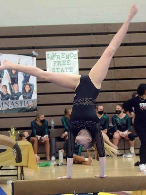 Newton foreign exchange student Cecilia Merlini competes on the balance beam at the state meet.