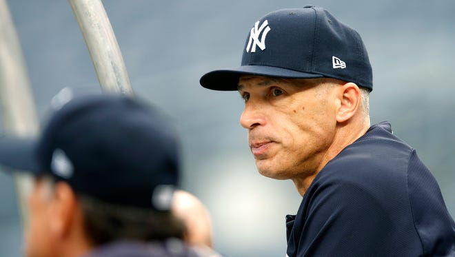 New York Yankees manager Joe Girardi watches his team take batting practice before an American League Division Series baseball game against the Cleveland Indians in New York, Sunday, Oct. 8, 2017. The Yankees are 0-2 in a best of five series against the heavily favored Indians.