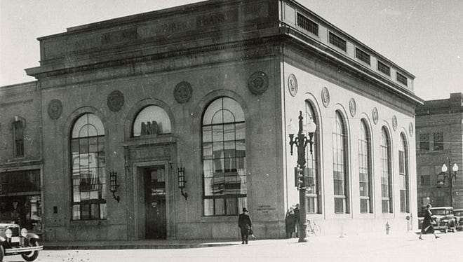The National Manufacturer's Bank was founded in 1881 by a group of local citizens. This building, shown in 1930 in Neenah, was built in 1923 at the southeast corner of Commercial Street and Wisconsin Avenue. It was razed in the early 1970s.