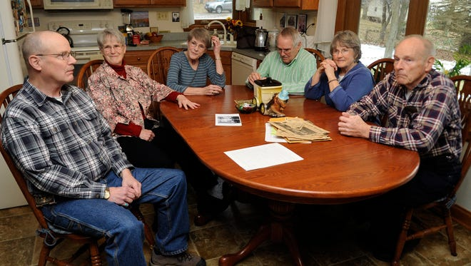 From left, Bill Nungesser, Mary Moreland, Nancy Cruit, Lee Nungesser, Sue Kilbarger and John Nungesser talk about the fire that destroyed their home in Logan 60 years ago Tuesday at Kilbarger's home in Lancaster. The Nungesser family, including 12 children, made it out of the house safely the night of the fire and moved to Lancaster with the help of the community.