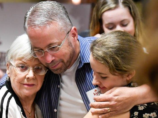 South Heights Elementary Principal Rob Carroll, a board member of the Audubon Kids Zone, gets hugs from his mother Christy Carroll and his daughter Sydney Carroll after he received the Rotary Hometown Hero Award in July 2016.