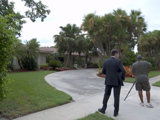 A local TV news crew scouts around a home on Scott Drive in the Estates section of Marco. Records show it is owned by Dr. Walter J. Palmer of Minnesota. Latest sale reflected is $1.1 million in 2013. Its 1989 selling price was $425,000.