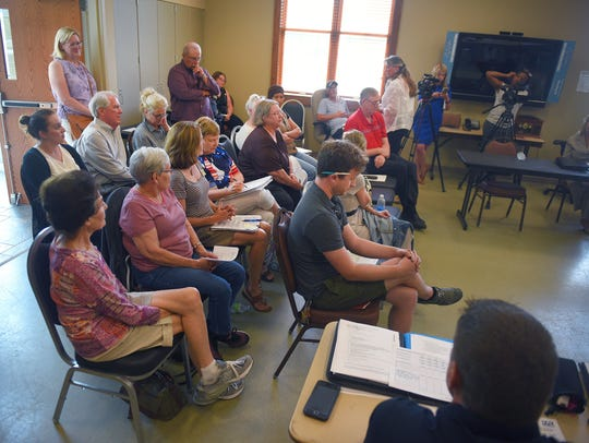 People attend a meeting to hear councilor Theresa Stehly
