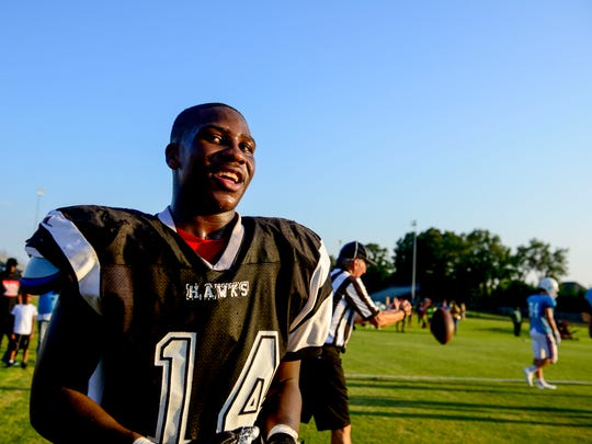 South Side running back Quad Greer (14) smiles towards his team in a TSSAA high school football game between South Side and University School of Jackson (USJ) at University School of Jackson in Jackson, Tenn., Friday, Aug. 3, 2018.