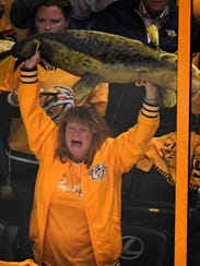 A Preds fan holds up a fake Catfish in the second period
