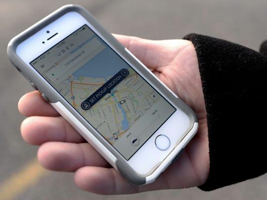 Uber Driver Taylor Vanden Bush demonstrates what customers