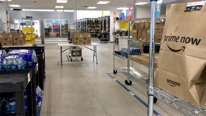 Orders wait in the shipping area at the Amazon fulfillment center. Amazon may soon have a new distribution center in Pewaukee.