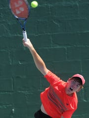 San Antonio's Trey Hilderbrand serves to Seabrook's Reed Collier. Hilderbrand beat Collier 6-0, 6-1 to win the Boys' 18 Singles title at the USTA Texas Slam on Saturday.