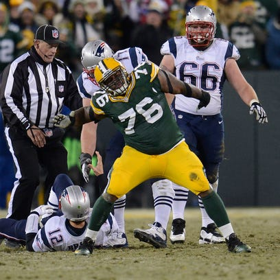 Green Bay Packers defensive tackle Mike Daniels celebrates