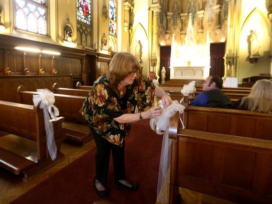 Chapel Hill hostess Nancy Jennings attaches arrangements