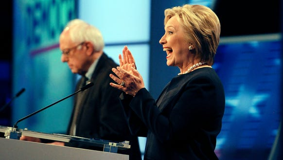 Hillary Clinton and Bernie Sanders take part in the