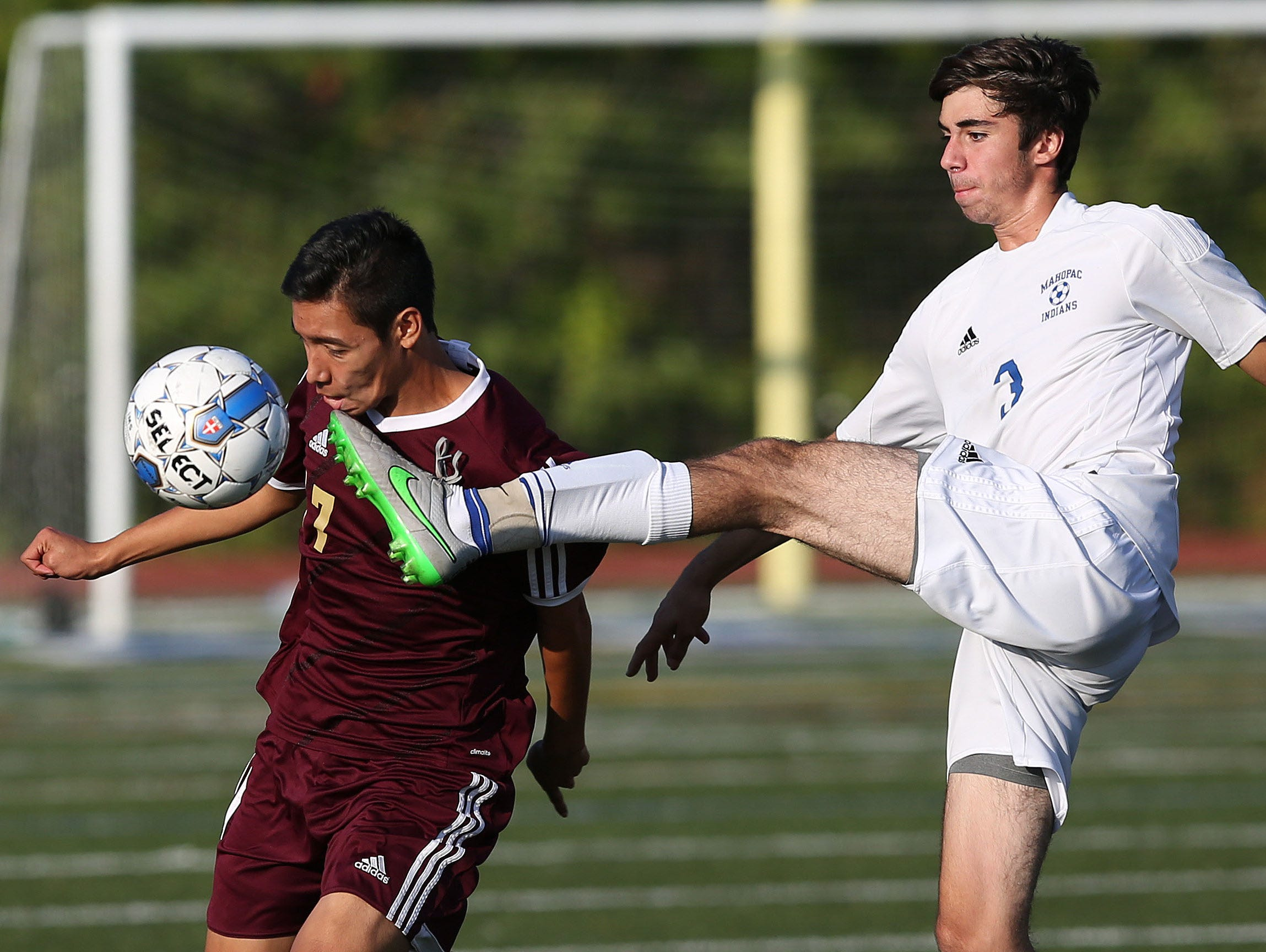 Arlington's Juan Lavariega (17) tries to control a pass as he takes a foot to the face from Mahopac's Paul Magnesio (3) during a boys soccer game at Mahopac High School Oct. 8, 2015. Arlington won the game.