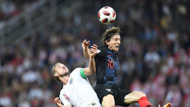 Croatia midfielder Luka Modric goes up for the ball against England's Harry Kane.