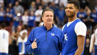 Part of Kentucky coach John Calipari's relationships with players like Andrew Harrison (right) is fostered by the team's work with sport psychologist Bob Rotella.