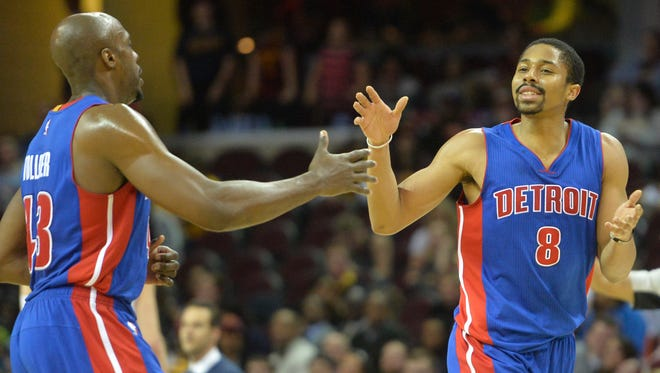 Detroit Pistons guard Spencer Dinwiddie, right, celebrates an overtime basket with forward Anthony Tolliver against the Cleveland Cavaliers at Quicken Loans Arena.