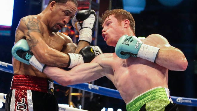 Canelo Alvarez, right, throws a punch at James Kirkland at Minute Maid Park. (Troy Taormina, USA TODAY Sports)