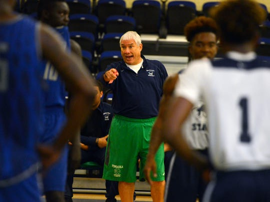 Pensacola State head basketball coach Pete Pena directs his players Sunday during the UWF-PSC scrimmage at PSC.