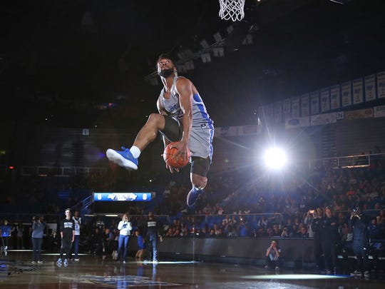 MTSU junior guard Antwain Johnson goes up for a dunk during Murphy Madness on Oct. 26, 2017. Johnson won the event's dunk contest for the second year in a row.