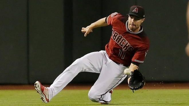 Apr 22, 2018: Arizona Diamondbacks center fielder A.J. Pollock (11) makes the sliding catch for the out against the San Diego Padres in the fourth inning at Chase Field.