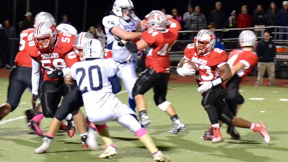 Messiah Horne turns upfield Friday during Somers' 55-27 win over Byram Hills in a Class A play-in game.