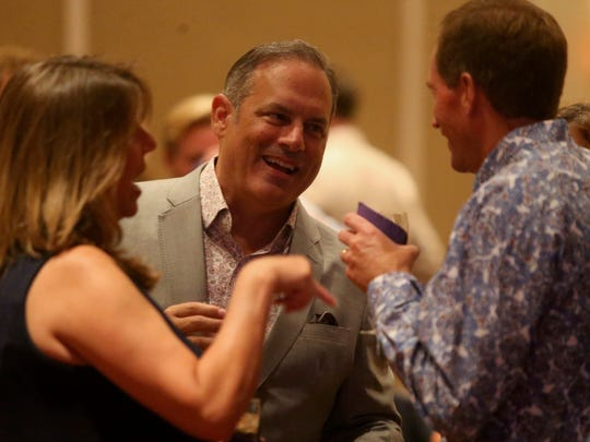 City Commissioner Scott Maddox hangs out with Paige Carter-Smith at the Saturday night banquet of the Greater Tallahassee Chamber of Commerce's 2017 Community Conference at the Omni Amelia Island Plantation August 12.