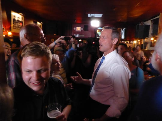 Former Maryland Gov. Martin O'Malley speaks with a Johnson County crowd Thursday at the Sanctuary Pub in Iowa City.