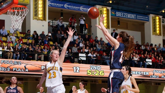 Eastchester's Cassidy Mitchell (13) puts up a shot as Panas' Melissa Keefe (23) defends in the Section 1 Class A girls semifinal basketball game at the Westchester County Center in White Plains on Thursday, March 2, 2017.