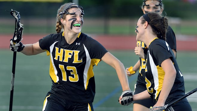 Honeoye Falls-Lima's Katie Stankaitis, left, and Kayla O'Connell celebrate their win over Penn Yan in the Section V Class C Championship played at Eastridge High School in Irondequoit on Wednesday, May 27, 2015. No. 2 seed HF-L won the Class C title with a 12-10 win over No. 1 Penn Yan .