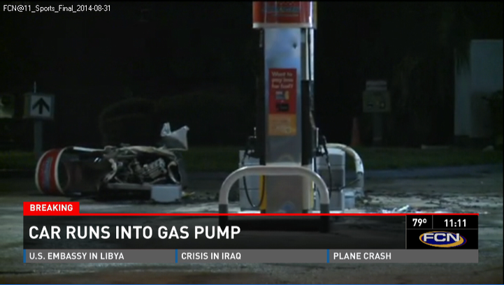 A gas pump completely detached and laying on the ground after it was hit by a car.