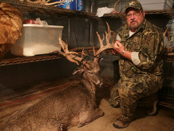 Ronnie Cook, a hunter from Arkansas, shows off a trophy buck he shot at Oak Creek Whitetail Ranch, Bland, Mo.